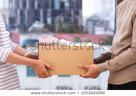 Férfi ruházat adomány doboz fiatalember fából készült Stock fotó © AndreyPopov