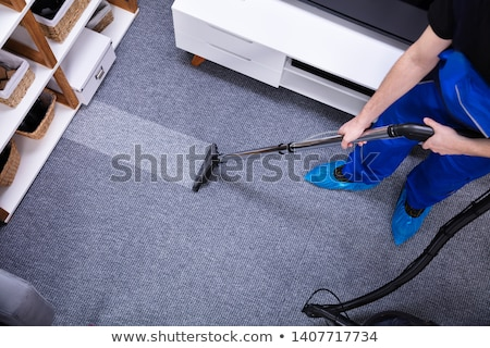 janitor cleaning floor with vacuum cleaner stock photo © andreypopov