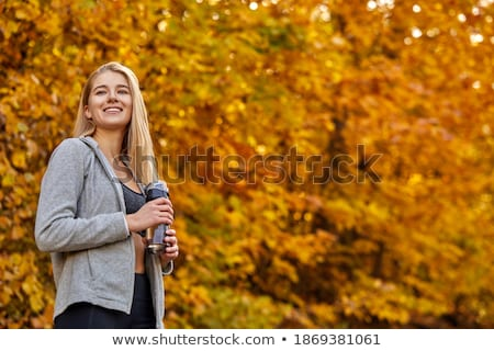 blond woman running outdoors on a cold winter day stock photo © lopolo