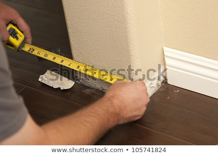 Contractor Installing New Baseboard with Bull Nose Corners and N Stock photo © feverpitch