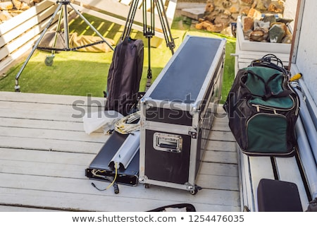 Video production gear on a set - big cinema lights and light rigging system. Stock photo © galitskaya
