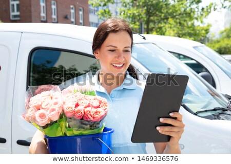 Homme fleuriste bouquet bleu seau Photo stock © AndreyPopov