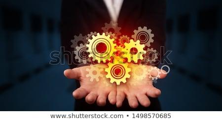 Versnellingen hand business technologie industrie Stockfoto © ra2studio