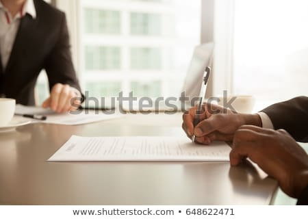 Business person signing a contract, focus on signature. Stock photo © lichtmeister