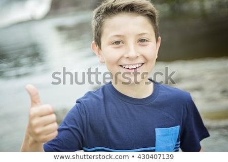 Közelkép aranyos 8 éves fiú boldog gyermek Stock fotó © Lopolo