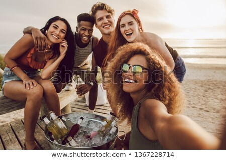 friends with drinks photographing at summer picnic Stock photo © dolgachov