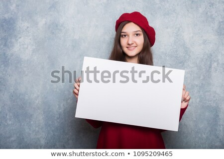 red haired teenage girl holding empty hands stock photo © dolgachov