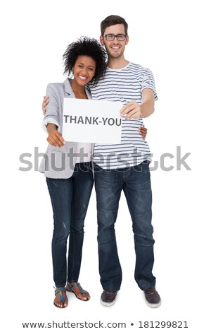 Front view of caucasian woman standing and holding american flag while her multi ethnic friends havi Stock photo © wavebreak_media