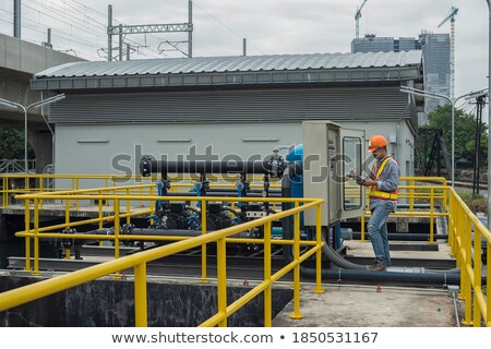 repairman engineer control panel valve equipment in a boiler hou Stock photo © Lopolo