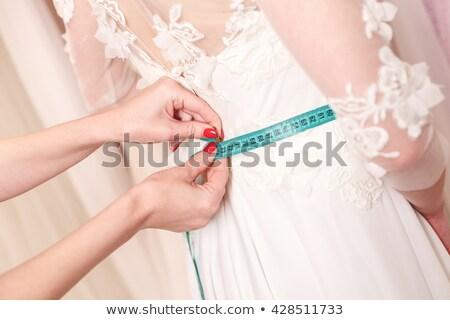 Vestido de novia sastre vestido sonriendo cinta métrica jóvenes Foto stock © pressmaster