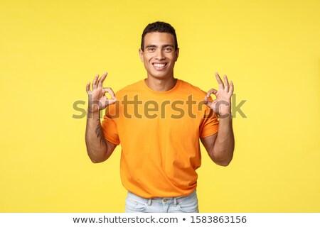 Mutlu adam dövmeli kol turuncu Stok fotoğraf © benzoix