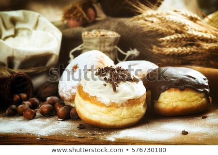 Frosted sprinkled donuts, sweet pastry dessert on rustic wooden  Stock photo © Anneleven