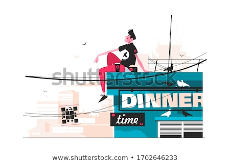 Fickó eszik harapnivalók tető fiatalember ül Stock fotó © jossdiim