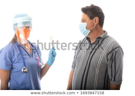 Healthcare worker swabbing a patient for respiratory viruses COV Stock photo © lovleah