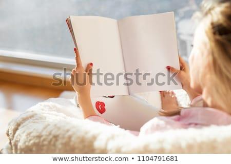 Woman reading magazine in cozy room Stock photo © dashapetrenko