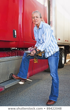 Blonde woman doing pretrip inspection Stock photo © rcarner