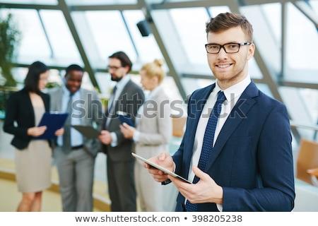 молодые · бизнесмен · оружия · сложенный · глядя · белый - Сток-фото © iko