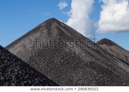 Crane and piles of coal Stock photo © deyangeorgiev