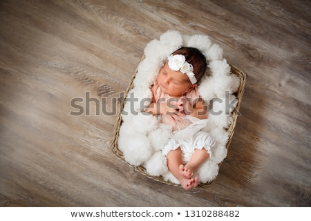 Girl with basket for linen Stock photo © RuslanOmega