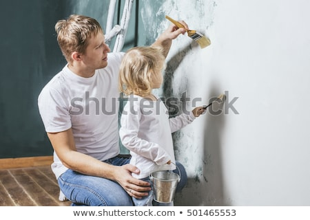 mother and son with rollers and brushes Stock photo © Paha_L