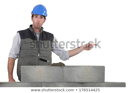 Architect stood by wall pointing Stock photo © photography33