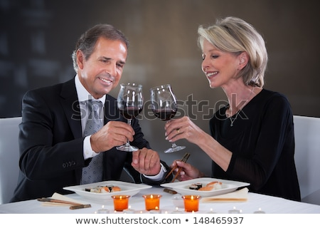 âgées · couple · potable · vin · restaurant · homme - photo stock © photography33