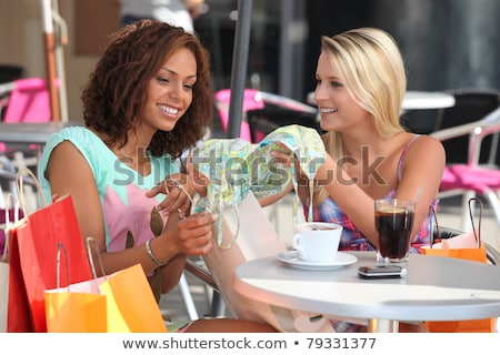 Friends comparing purchases in a cafe Stock photo © photography33