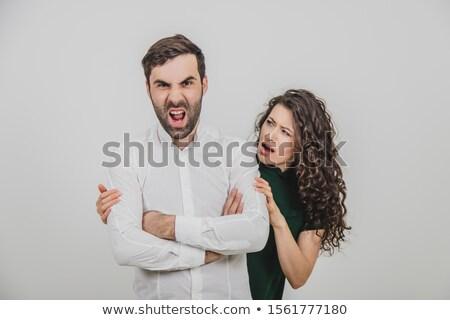 Man dom onzeker gezicht hand Stockfoto © photography33