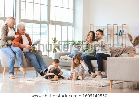 Father reading newspaper, daughter watching TV Stock photo © pzaxe