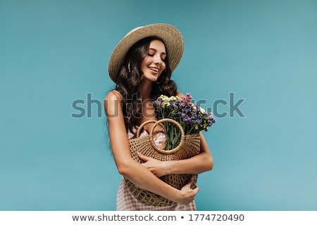gorgeous brunette beauty shot with flower stock photo © lithian