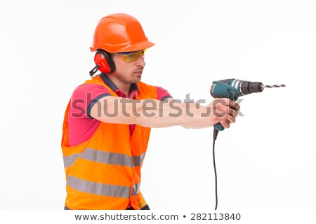 Worker aiming his power drill Stock photo © photography33