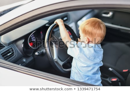 Boy looking at driving licence Stock photo © photography33