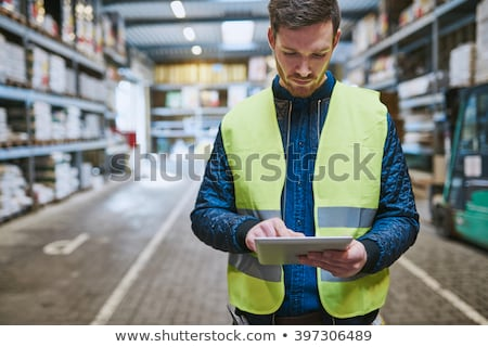 young blue collar in factory with computer Stock photo © photography33