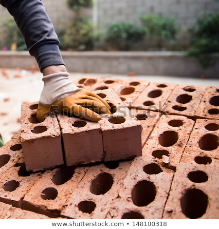 worker carry brick on construction site stock photo © lightkeeper