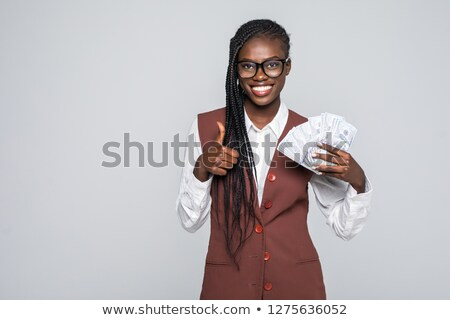 Enthusiastic woman giving the thumb's up and holding a whiteboard Stock photo © photography33