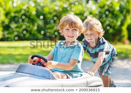 Kettő fiatal fiúk játszik körül nevet Stock fotó © grafvision