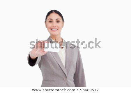 blank business card being presented by saleswoman against a white background stock photo © wavebreak_media