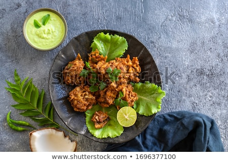 Asian appetizer - Pakoras Stock photo © kalozzolak