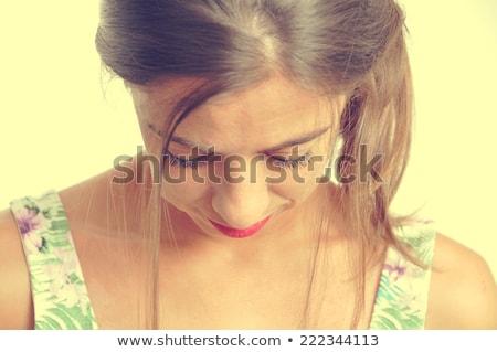 Utangaç kadın bakıyor yalıtılmış gülen Stok fotoğraf © stockyimages