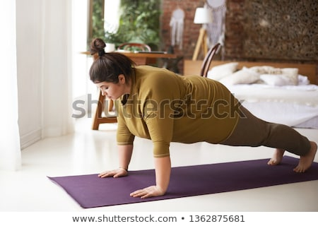 Shapely brunette woman in the bedroom Stock photo © konradbak