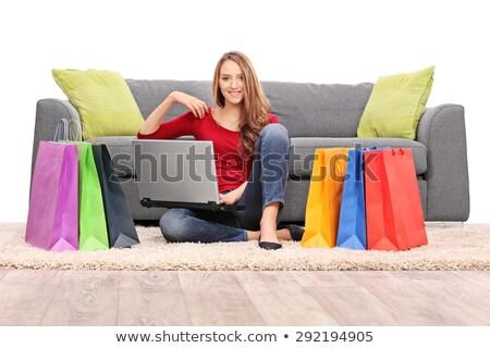 nő · ül · padló · bevásárlótáskák · mutat · barát - stock fotó © dolgachov