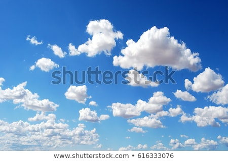 Stock photo: Blue sky with fluffy clouds