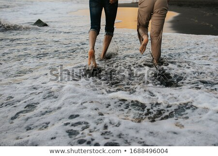 Pieds nus humide sable plage Photo stock © feedough