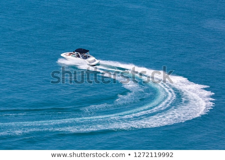 Kicsi motorcsónak kék tenger tengerpart víz Stock fotó © Nneirda