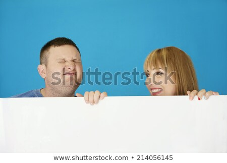 Middle Age Couple Behind White Cover Stock photo © stryjek