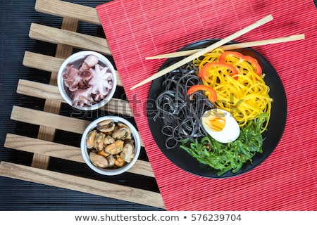 bowl of marinated greek salad with red napkin stock photo © juniart