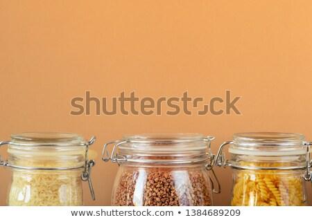 Glass jar full of brown rice Stock photo © raphotos