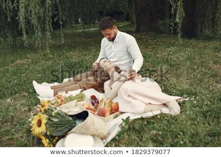 肖像 · 座って · 公園 · 草 · 男 - ストックフォト © deandrobot