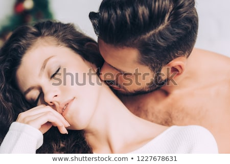 apaixonado · homem · beijando · pescoço · jovem · isolado - foto stock © AndreyPopov