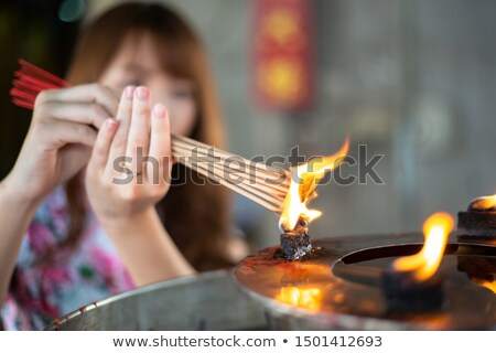 Asian Buddhist woman praying Stock photo © smithore